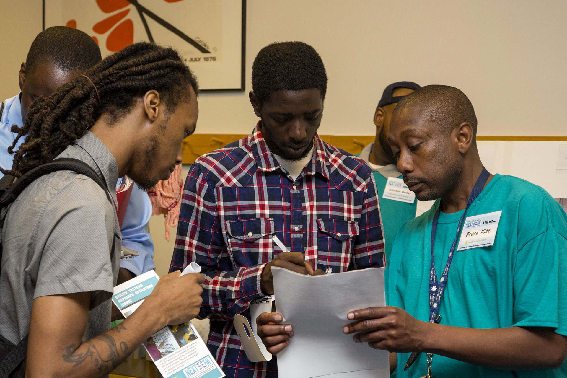 Checking a schedule at the OFMR Career Fair 2014