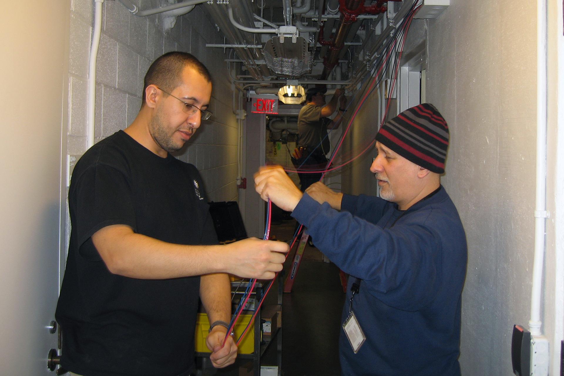 Flecha, Bahou and Fabio installing power
