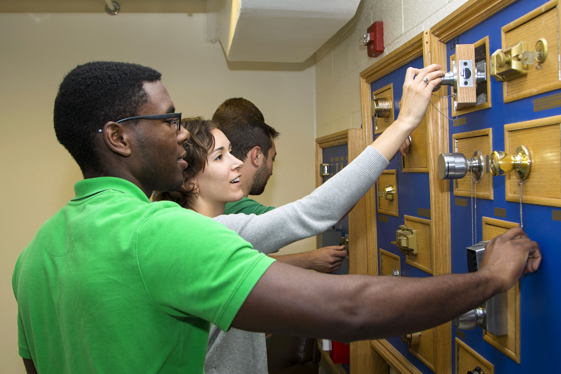 OFMR interns examine different kinds of locks